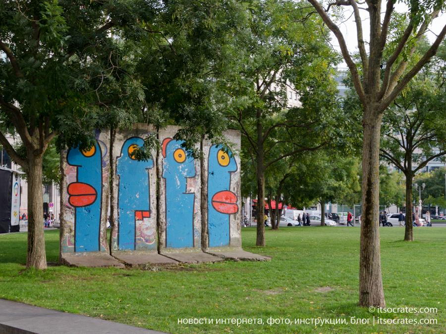 Достопримечательности Берлина - Берлинская стена разделявшая Германию и ГДР - куски стены по всему городу, раскрашенные граффити